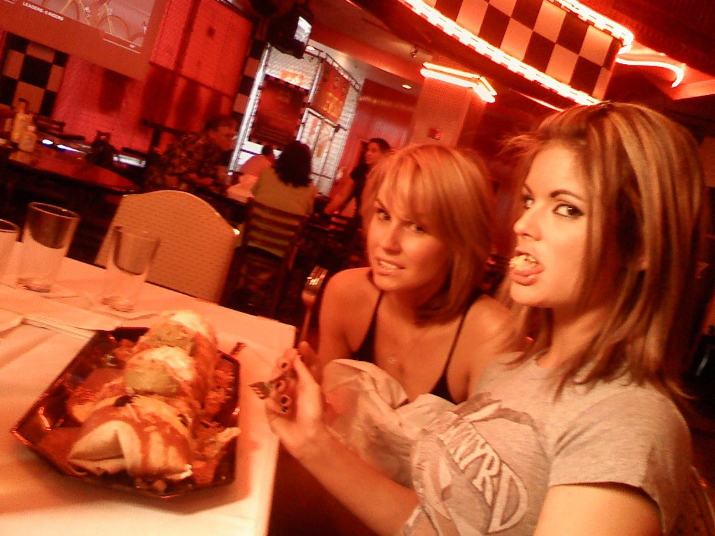 Playboy Playmate Laura Croft & Vegas Showgirl Kiltie Colleen chow down at NASCAR Cafe/photo:ECG