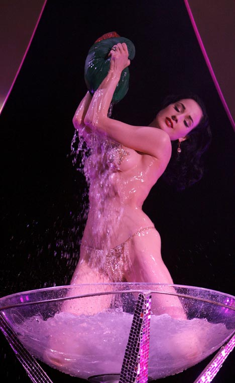 Dita Von Teese performing in her custom-designed champagne glass bath.
