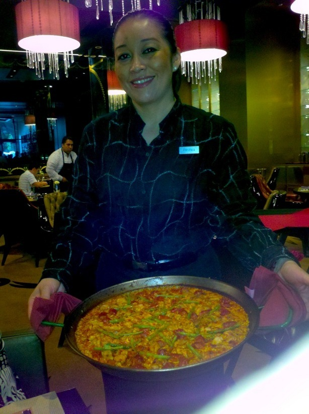 Isn't this exactly the perfect woman to be serving your paella? The Estate Merlot paired well with this...