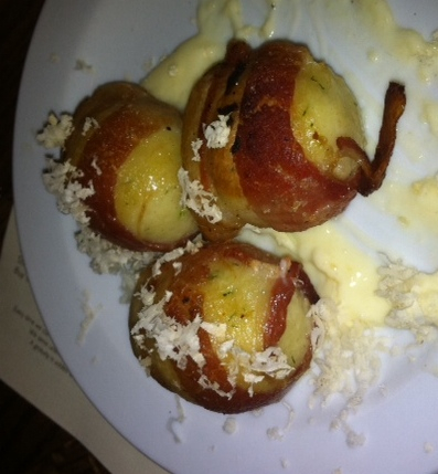 Bacon-wrapped matzoh balls. One got snatched up before the camera even came out!